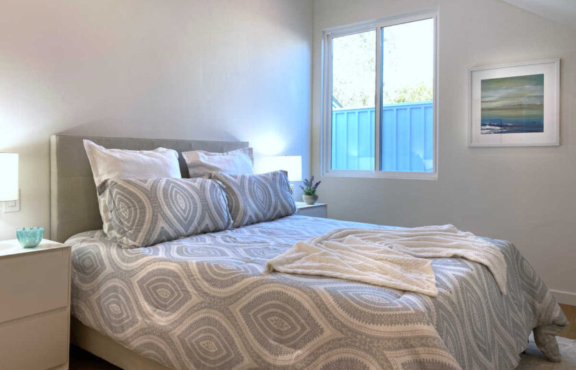 Boho Chic beach house home staging at Faria Beach, second guest bedroom facing grey queen bed