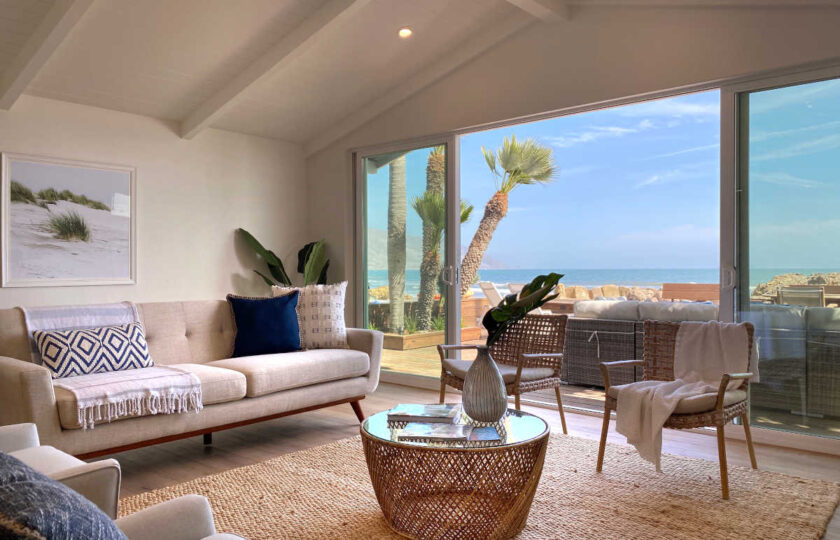 Boho Chic beach house living room facing couch and ocean behind