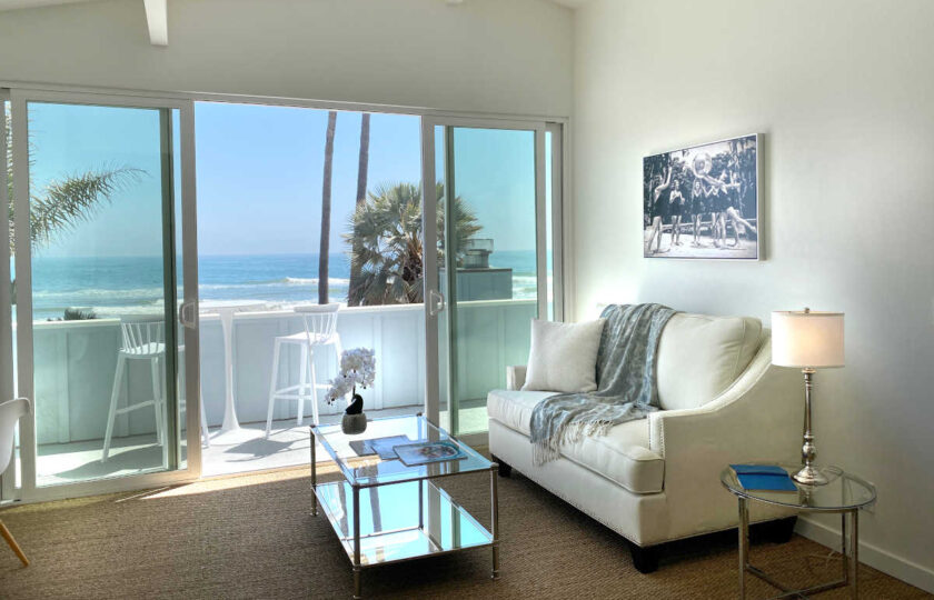 Boho Chic beach house home staging at Faria Beach, seating area and balcony in master bedroom