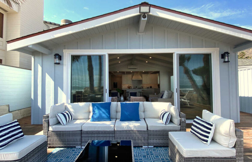 Boho Chic beach house staging of patio facing away from ocean towards house