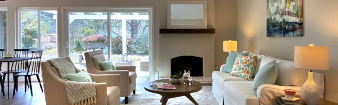 Transitional living room staging facing fireplace