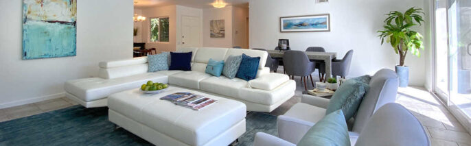 contemporary style living room with sectional and ottoman in the center