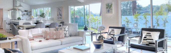 Mid-century modern style living room in Woodland Hills with a couch and chairs around the coffee table placed in the center